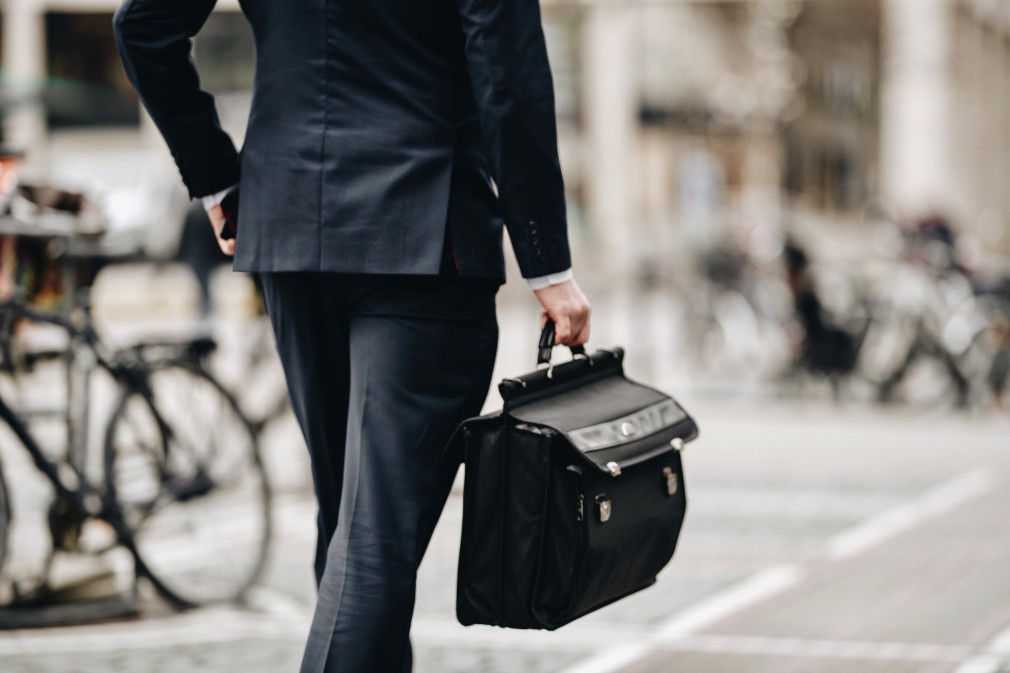 walking to the office with a briefcase