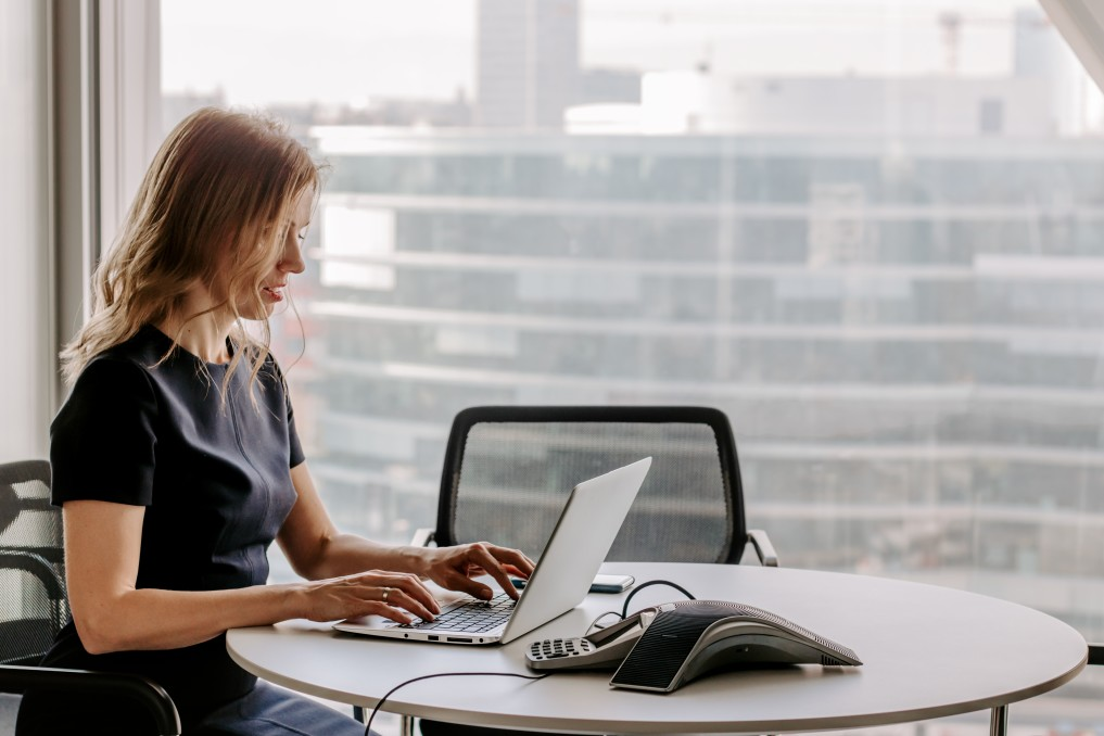 women working at a desk in the city